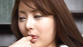 Mei Sawai Asian pleasures her hairy pussy with fingers at of