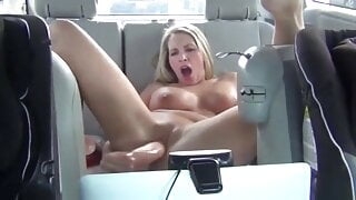Gorgeous MILF fucks herself in the car in both holes