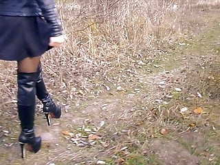 High boots fetish High boots, nylon tights and a short dress