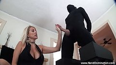 dominant MILF Dallas gives Femdom handjob to bound cock