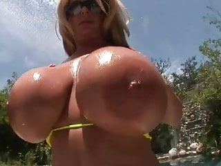 Huge fake tits fucks cock hard Huge fake tit milf gets fucked and her tits covered in cum
