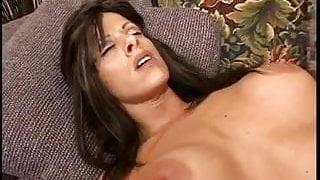 Beautiful young slut with big fake tits smokes a cig during handjob