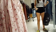 Candid voyeur teen in cheeky shorts clothes shopping
