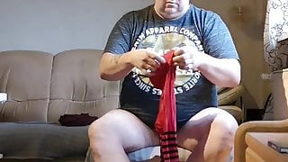 Putting on Black and red tights