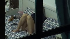 Hot girl masturbating on bed voyeur window