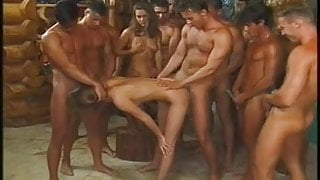 a crowd of men and a couple of girls. Gangbang