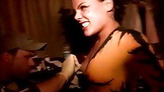 Alecia Moore aka Pink getting her Nipple pierced.