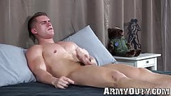 Muscular young soldier strips naked and starts masturbating