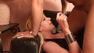 Horny cougar fucks a younger blonde with a strap-on
