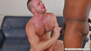 Hunky bear cums while riding black cock