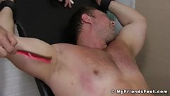 BDSM hunk tied up to have his buff body and bare feet teased
