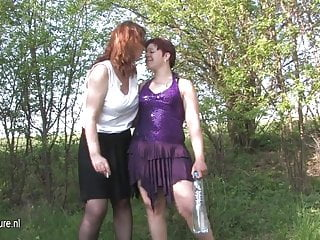 Amateurs in the woods Two old and young lesbians go at outside in the woods
