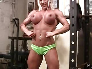 Naked woman at gym Naked female bodybuilder rubs her clit in gym