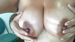 Oiling up some big natural tits