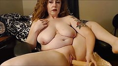 Classy redhead cougar with big tits squirting