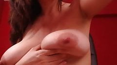 Shaking her big tits and licking nipple on cam