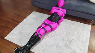Zentai Girl Strapped Up In Belt Bondage