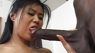 Asian babe takes a black dick