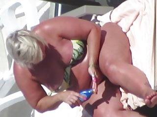 Bbws on the beach Bbw gilf in bikini nip-slip while tanning on the beach