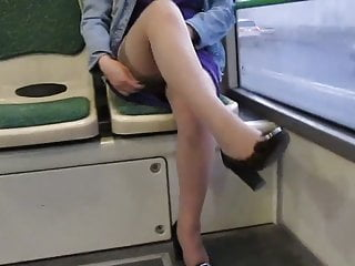 Mature stockings and suspenders - Girl checking stockings and suspenders in a bus