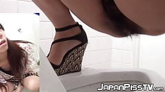 Japanese hotties filmed while peeing at public toilette