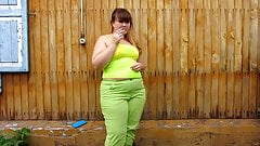 Chubby woman peeing in her pants