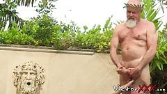 Mature men are having fun while outdoors as they raw fuck
