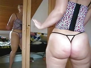 Fat white girl big tits White girl with a fat ass stripping and dancing.