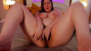 Chubby with hairy pussy caresses herself on camera