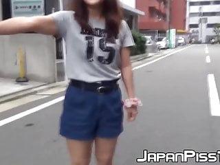 Teenage girl pee pants - Teenage asian redhead filmed while peeing on the street