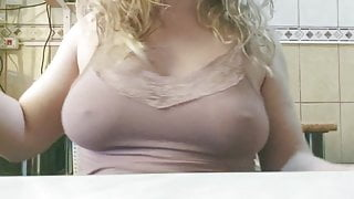 Blond girl is shaking her big tits