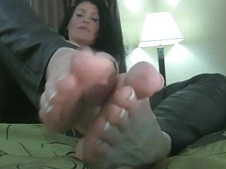 Sexy male outfits - Sexy milf leather outfit shows her sexy soles