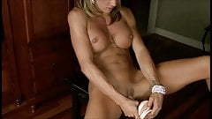 Fit blond with perfect tits fucking herself with a dildo