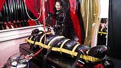 Mistress Kim using Serious Kit on her rubberslut