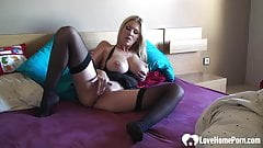 Blonde MILF in stockings shows her goods