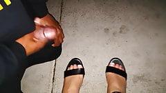 Black pervert cumming on sexy feet in black sandal in public