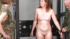 Young bdsm brunette soldier girl is restrained and tortured in dungeon
