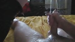 He jerks off and huge cumshots after she pisses on his dick