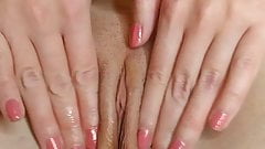 Fingering a pink tight pussy