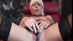 Check My MILF granny with two toys in her holes