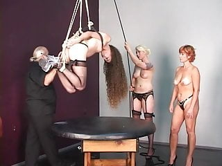 Hung hairy man Blonde redhead and brunette bdsm slaves bound to and hung over table by old man