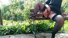 Extreme pissing in the park on the bench