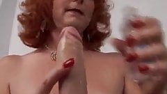 Sexy mature redhead frigs her pussy until she squirts