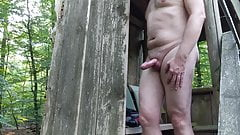 Guy strips and walks nude in the forest with a nice finish