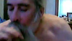 bearded daddy bear sucking cock