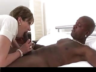 Black cock and mature lady British lady in stockings takes black cock.