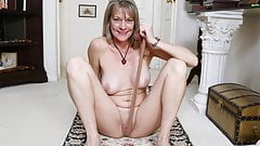 American milf Lucky rubs one out on the floor.