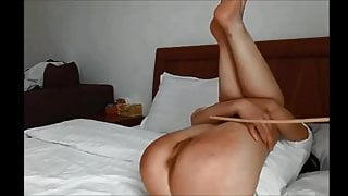 Chinese girl endures slender cane