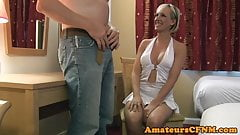 Busty CFNM amateur sensually munching on cock