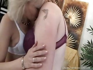 Mature women fucking sones Sexy mature women fuck each other with a strap-on